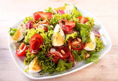 side salad: Close up Gourmet Appetizing Vegetable Salad with Egg Slices on a White Plate, Ready to Eat on the Table.