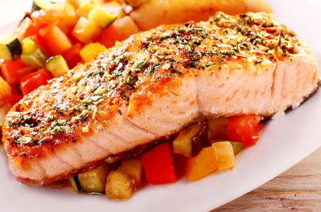 salmons: Close Up of Herb Roasted Fillet of Salmon Served on Bed of Fresh Chopped Salsa and Served on White Dish