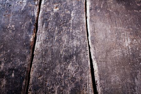 oblique: Old weathered wooden table background with grunge boards or planks viewed high angle receding perspective, empty for your product placement Stock Photo