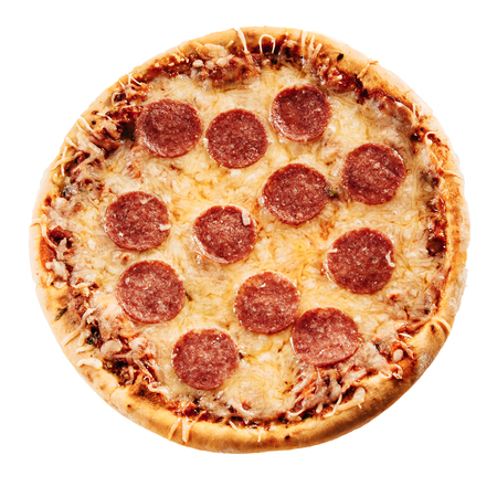 salami slices: Round homemade tasty pizza with crispy dough topped with mozarella and salami slices, high-angle close-up isolated with copy space