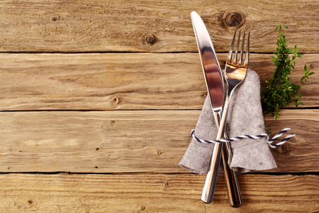 Bavarian cutlery on wooden table with copyspace for oktoberfest or other german festivals