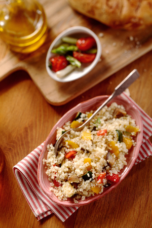 high angle view: High angle view of Veggie quinoa recipe on brown wooden background with blur Stock Photo