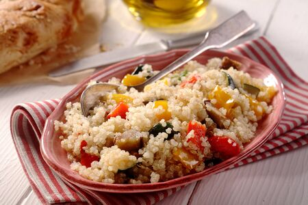 sumptuous: Modern vegetarian quinoa menu with aubergine, peppers and cougars with bread and oil. Stock Photo