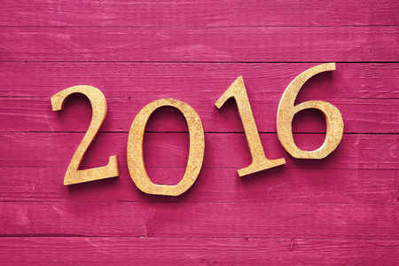 hogmanay: Gold 3D 2016 Lying on a Wooden Magenta Table for New Year Concept Stock Photo