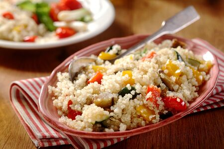 sumptuous: Tasty Horizontal quinoa menu with red and white napkin in a beautiful dish. Veggie Concept.