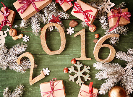 christmas tide: Top View of Assorted Christmas or New Year Decorations on Wooden Table with Year 2016.