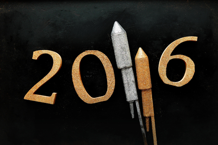 hogmanay: Gold and Silver 3D New Year 2016 Design Against Silhouette Wet Glass Background. Stock Photo