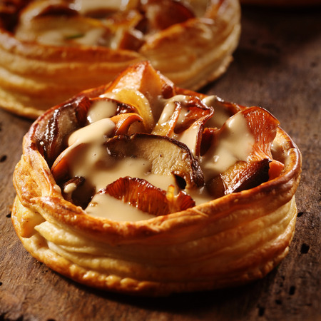 assorted: Delicious gourmet individual mushroom pie in a flaky pastry base with assorted fresh seasonal autumn fungi in a creamy savory sauce
