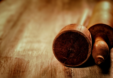 free backgrounds: Vintage wooden baking utensils with a rolling pin and masher lying on a wooden table with copyspace, low angle view