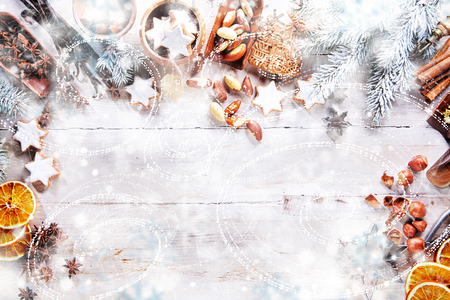 table: White Christmas Background with empty copy space. Cakes and nuts as a decorative xmas frame for xmas concept or cards