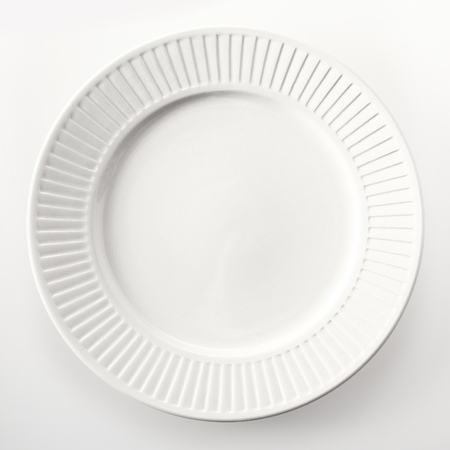 high angle: Close up High Angle View of an Empty Round White Dinner Plate Isolated on White Background.