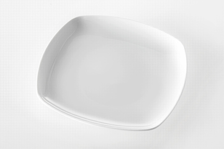 product placement: Empty plain white rectangular plate for serving dinner with copyspace for your food or product placement over a white background, high angle view