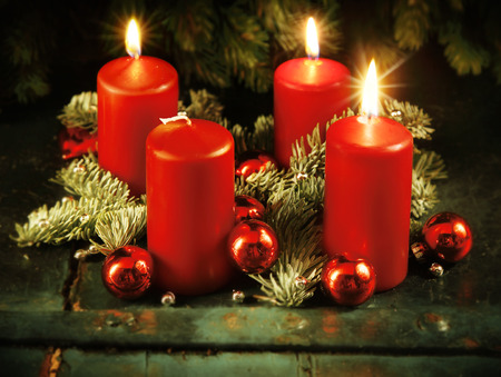 rote: Xmas Advent wreath with three lighted candles for the 4th advent sunday rustic christmas traditional concept