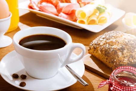 energising: Freshly brewed coffee with bread and slices of meat Stock Photo