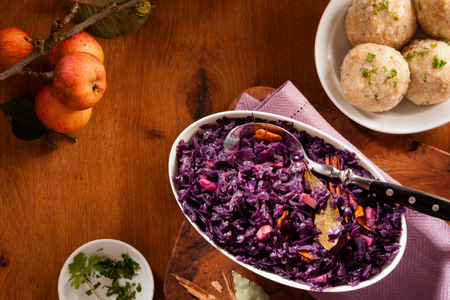 Assorted traditional german dumplings and red cabbage in overhead view