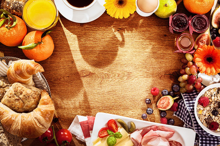 Various breakfast ingredients as border on table