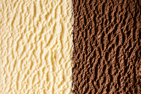 Full frame background texture of delicious Italian chocolate and vanilla bourbon ice creams in a half and half view of the surface Stok Fotoğraf