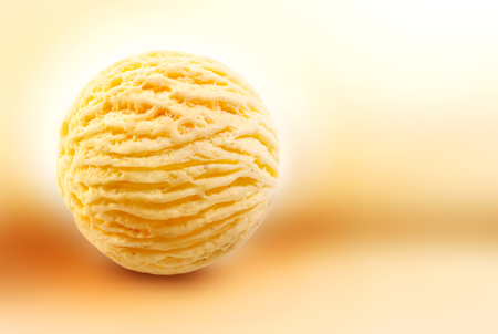 scoop: Single scooped ball of vanilla flavored ice cream over yellow background