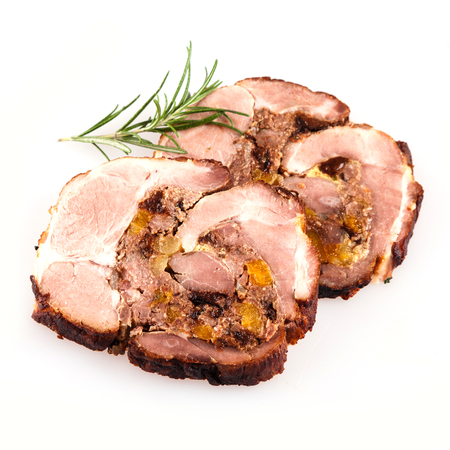 pork: Top down view of sliced of stuffed pork roast with rosemary sprig over isolated white background