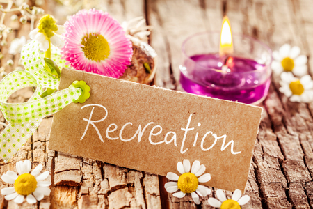 stressing: Pleasing display of handwritten recreation sign set on tree bark surface decorated with various flowers Stock Photo