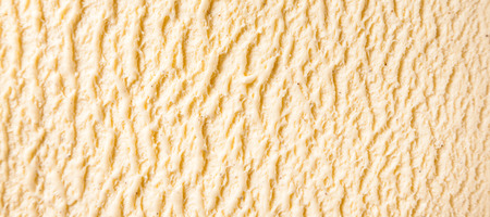 Fond de texture abstraite panoramique - Close Up of Ridges in Surface of Cream, Sweet and Cold Vanilla Bourbon Frozen Dairy Ice Cream Dessert Banque d'images - 53500374