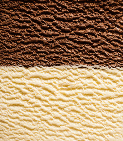 Full Frame background texture of half and half vanilla bourbon and chocolate ice cream divided neatly in the center viewed from above