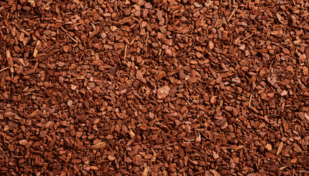 barks: Top down full frame background of brown natural tree bark mulch with copy space for gardening or nature concepts