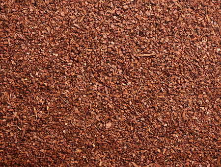 barks: Full frame background of brown natural tree bark mulch with copy space for gardening or nature concepts