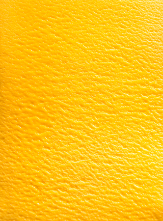 flavours: Delicious Italian mango sorbet gelato in a full frame background texture viewed from above