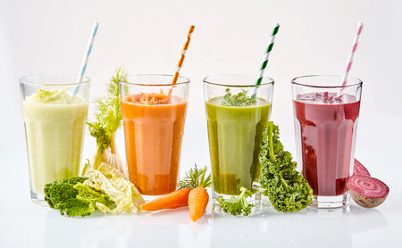 Fresh healthy vegetarian vegetable smoothies with fresh ingredients including cabbage, kale, carrots and beetroot for tasty drinks filled with vitality
