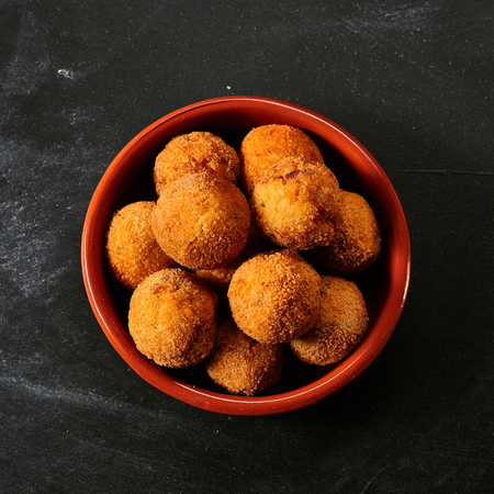 croquettes: Fried Spanish bacalao croquettes made with breaded salted codfish and served as traditional tapas or snacks, overhead view Stock Photo