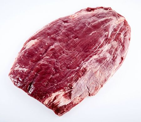 Prime cut of raw matured beef flank steak trimmed of fat ready for grilling or roasting isolated on white Stock Photo