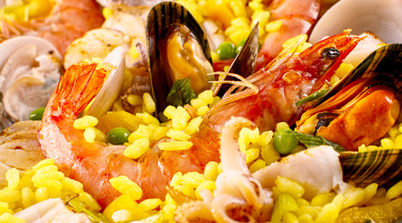 extreme close up: Extreme Close Up of Colorful Seafood Spanish Paella Rice Dish Made with Fresh Shellfish and Flavorful Yellow Rice - Full Frame Still Life