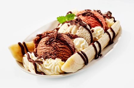 Delicious sweet banana split in bowl