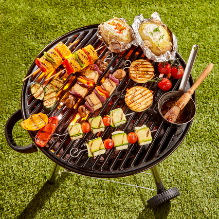 baked potatoes: High Angle View of Various Vegetarian Kebabs and Vegetables Cooking on Grill with Basting Sauce in Sunny Yard on Summer Day