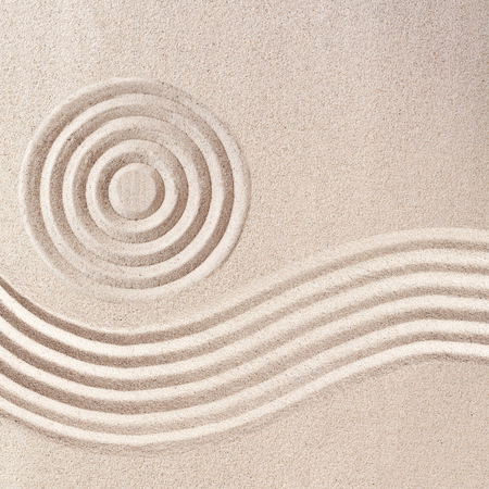 raked: Raked sand patterns in Japanese Zen Garden wit simple flowing waves and concentric circles in a square frame format Stock Photo