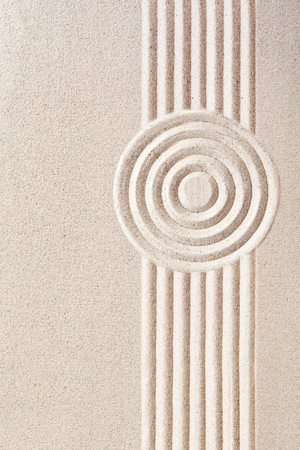 raked: Traditional Japanese sand zen garden with a raked pattern of concentric circles and straight parallel lines with copy space, a place of spirituality and tranquility