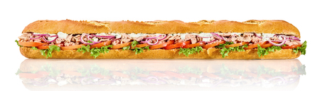 Long crusty French baguette with tuna salad filling on a reflective white background in panoramic banner format Stock Photo