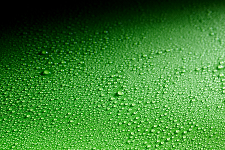 waxed: Background made from gradient black and green shiny surface covered by condensation Stock Photo