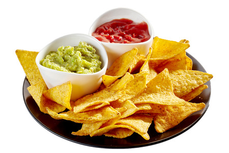 Round isolated plate of delicious nachos, salsa and guacamole over white background
