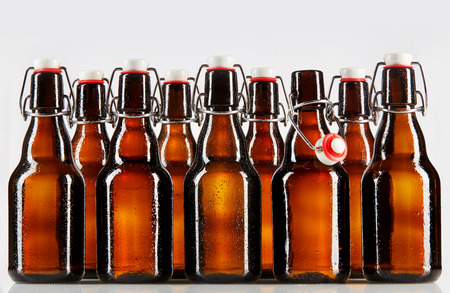 chilled: Beer packaged in clear brown unlabeled bottles two rows deep