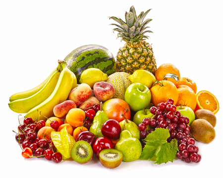 assortment: Still life of fresh healthy tropical fruit on white with bananas, watermelon, grapes, orange, kiwi, peaches, apricot, cherry, pineapple and apples