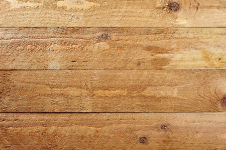 product placement: Background texture of natural rough wood planks with knots arranged parallel horizontally for product placement or as an architectural building concept