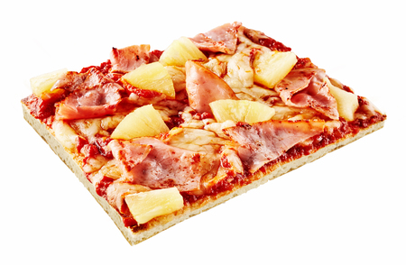 Rectangular slice of Italian Hawaiian pizza with pineapple and thinly sliced ham on a crispy thin base isolated on white