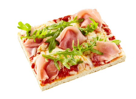 pizza base: Rocket and parma ham Italian pizza portion with melted mozzarella and tomato on a crisp thin pastry base isolated on white