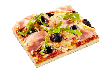 Italian pizza with black olives, rocket or arugula and ham on a thin pie crust base viewed high angle over white