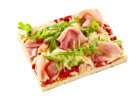 Fresh rocket or arugula and ham Italian pizza on a crispy thin crust with tomato and mozzarella isolated on white