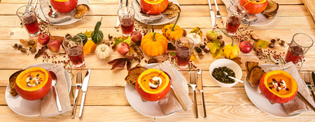 Setting for six to enjoy a spicy and delicious pumpkin soup, bread and tea dinner or lunch