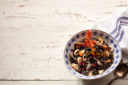 langoustine: Delicious bowl of frutti de mare with copy space on old wooden painted white table