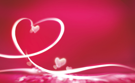 Cute heart shaped lights over pink background with copy space to side for concept about marriage or Valentines Day